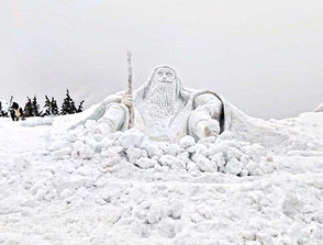 Giant snow sculpture of Krakonoš on Labská bouda